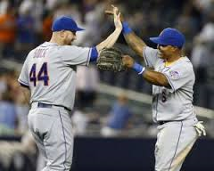 John Buck and Marlon Byrd will have more celebrating to do after not getting traded from the Mets at the deadline